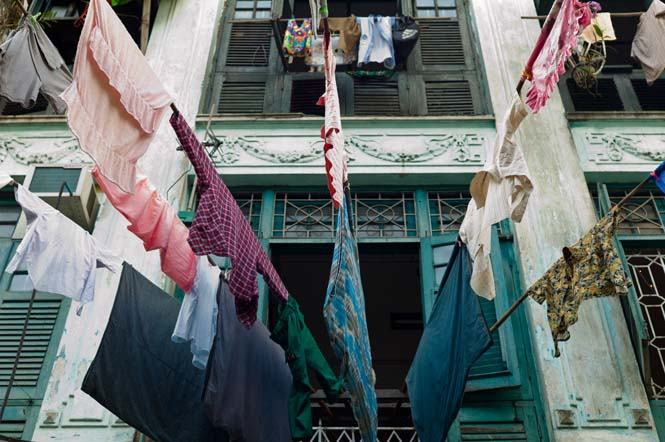 With intermittant power and driers a rarity, Yangon's residents hang their clothes to dry over the city's dusty streets