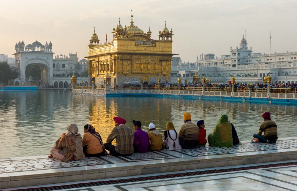 Pilgrims resting while others wait in line to see the first Holy Book of the Sikhs housed within the Harmandir Sahib