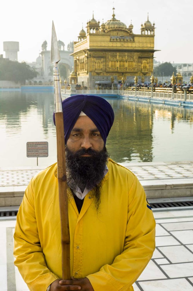 Guards at the Golden Temple wear yellow tunics. In the Sikh tradition, yellow represents our sense of self and the ideas of happiness and joy.