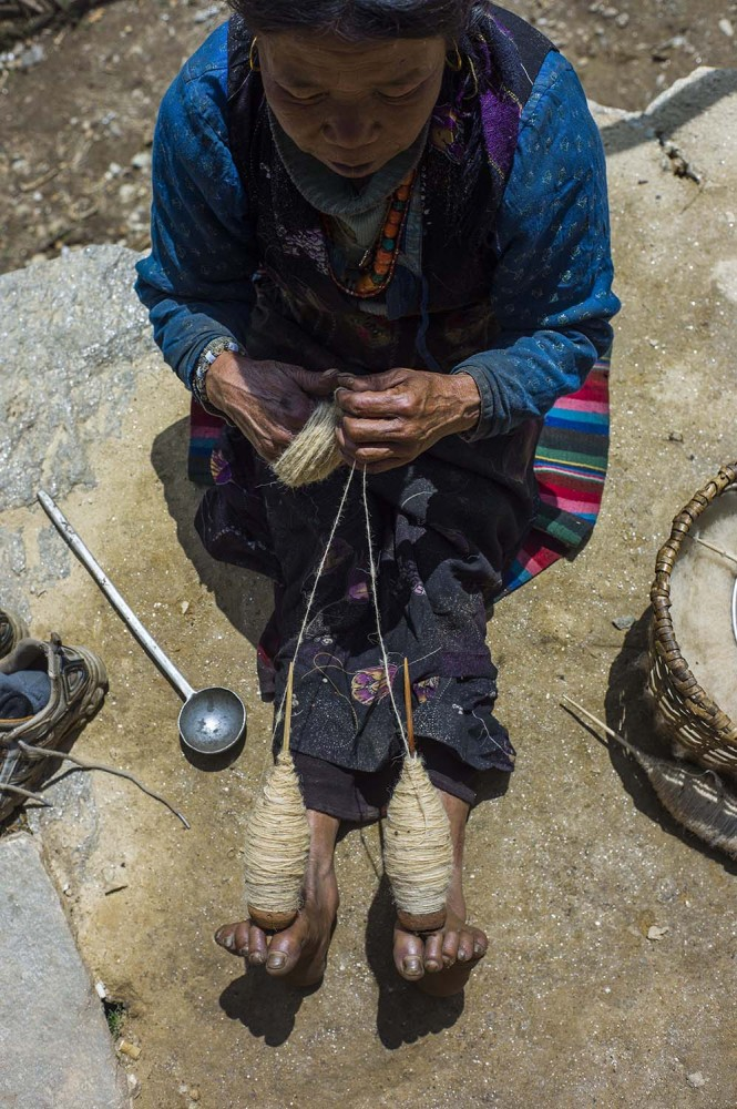 Along the trail rest stops offer weary hikers food and drink. At this one a woman was spinning wool by hand