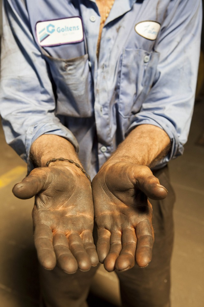 Dominic Rama's grease-stained hands