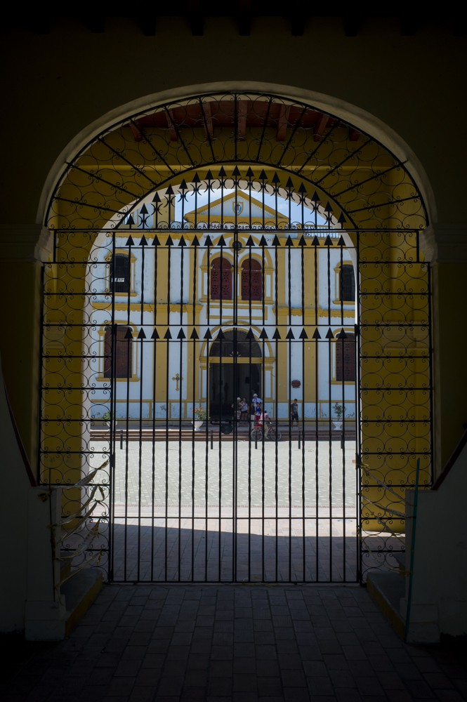 Iglesia Maria Inmaculada as viewed from inside Mompo's colonial Custom House, the former center of the town's commerce